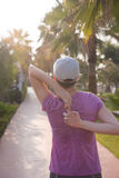 Woman  stretching before morning jogging Royalty Free Stock Photo