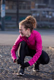 Woman  stretching before morning jogging Stock Photography