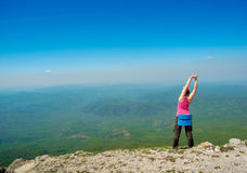 Woman stretching in mountains Royalty Free Stock Image