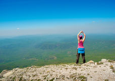 Woman stretching in mountains Stock Image