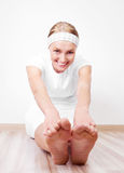 Woman stretching the muscles Royalty Free Stock Photography