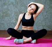 Woman stretching the musles Stock Image