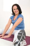 Woman Stretching On Mat Stock Photography