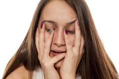 Woman stretching out her face Stock Image