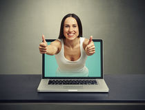 Woman stretching out of laptop Royalty Free Stock Photo