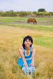 Woman stretching outdoors. Healthy active woman stretchs outside Royalty Free Stock Photography