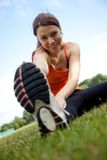 Woman stretching outdoors Stock Photo