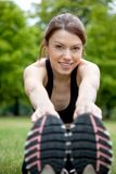 Woman stretching outdoors Royalty Free Stock Image