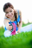 Woman stretching outdoors Royalty Free Stock Photography