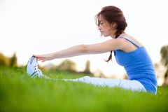 Woman stretching outdoors Stock Images