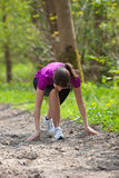 Woman stretching outdoors Royalty Free Stock Photo