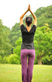 Woman stretching outdoors Royalty Free Stock Photos