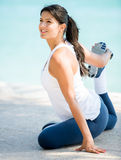 Woman stretching outdoors Stock Image