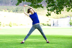 Woman stretching outdoors in park Royalty Free Stock Photo