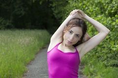 Woman stretching outdoors Stock Photos