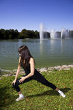 Woman stretching in the park Royalty Free Stock Photos