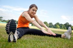 Woman stretching at the park Stock Photography