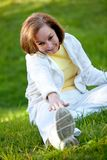 Woman stretching at the park Royalty Free Stock Image