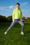 Woman stretching in a park Royalty Free Stock Image
