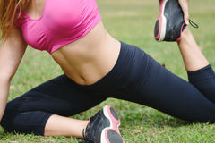Woman stretching in the park before Exercise. Stock Images