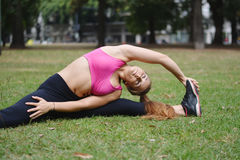 Woman stretching in the park before Exercise. Royalty Free Stock Photo