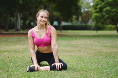 Woman stretching in the park before Exercise. Royalty Free Stock Photos