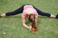 Woman stretching in the park before Exercise. Stock Image
