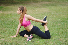 Woman stretching in the park before Exercise. Royalty Free Stock Image
