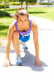 Woman Stretching On Park Footpath Royalty Free Stock Photos