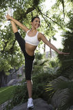 Woman Stretching In Park Stock Images