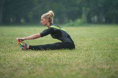 Woman Stretching In The Park Stock Photos