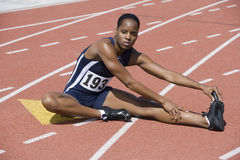 Woman Stretching On Race Track Royalty Free Stock Photos