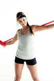 Woman stretching resistance band Stock Image