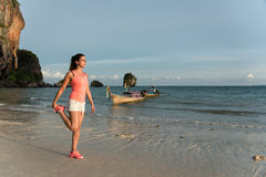 Woman stretching before running at the beach Royalty Free Stock Photos