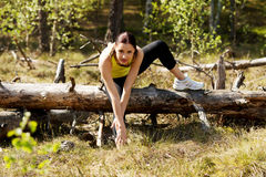 Woman stretching after running Stock Photography