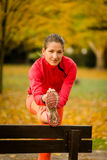 Woman stretching before running Royalty Free Stock Photos