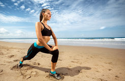 Woman stretching on the sea coast Stock Images