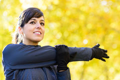 Woman stretching shoulder Royalty Free Stock Image