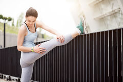 Woman stretching before some exercises Royalty Free Stock Image