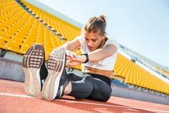 Woman stretching at stadium Stock Image