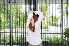 Woman stretching and standing while waking up in the morning. Woman stretching and standing while waking up in the morning Stock Photo