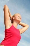 Woman stretching in sunlight Stock Photo