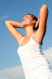 Woman stretching in sunlight Stock Photography