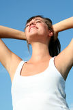Woman stretching in sunlight Royalty Free Stock Photography
