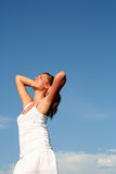 Woman stretching in sunlight Stock Image
