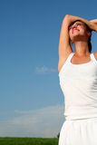 Woman stretching in sunlight Royalty Free Stock Photo