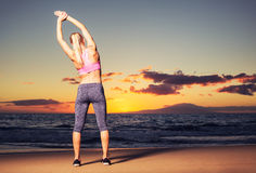 Woman stretching at sunset Royalty Free Stock Photo