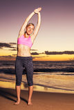 Woman stretching at sunset Royalty Free Stock Photography