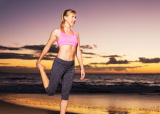 Woman stretching at sunset Royalty Free Stock Photos