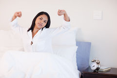 Woman stretching to wake up Stock Photography